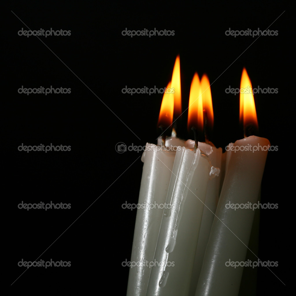 Sacred candles in dark on black background — Stockfoto #9987881