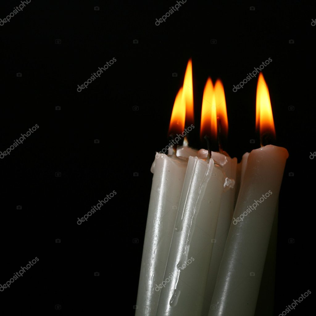 Sacred candles in dark on black background  Foto Stock #9987881