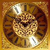 Golden wall clock — Stock Photo