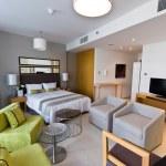 Interior of modern apartment - bedroom & lounge — Stock Photo