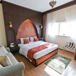 Interior of modern apartment - bedroom in Oriental style — Stock Photo