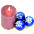 Purple Burning candle and blue decoration balls. — Zdjęcie stockowe