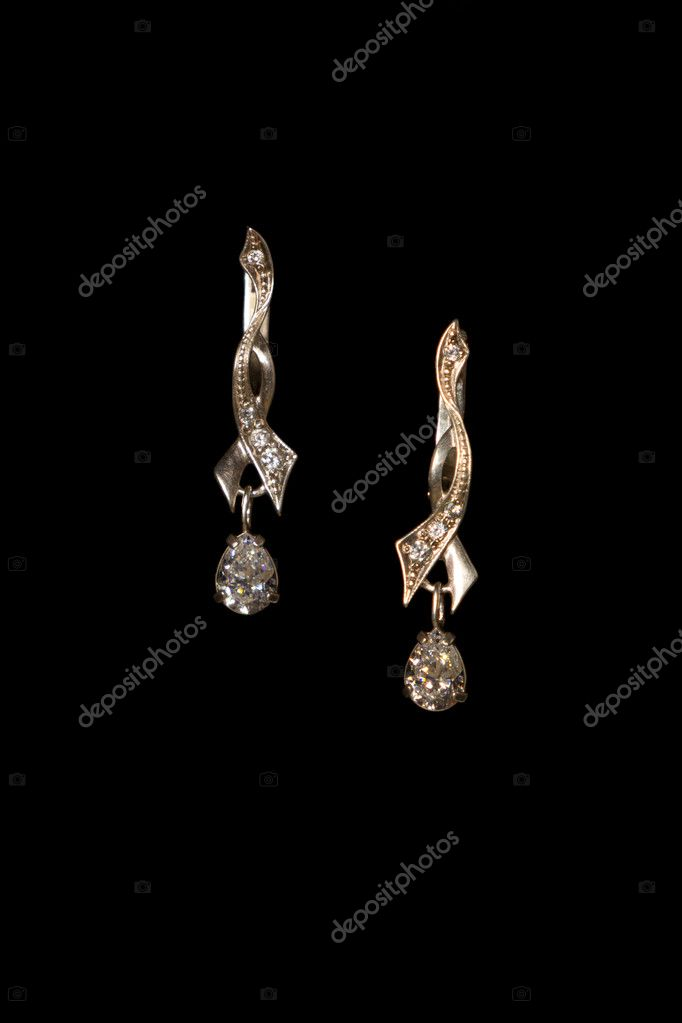 Shining elegant modern earrings with zircons isolated on black  Stock Photo #9688571