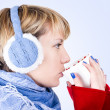 Blond girl drinks a tea. Image has clipping path. — Stock Photo