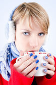 Girl holds cup of hot chocolate. Image has clipping path. — Stock Photo