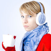 Blond girl holds cup of tea. Image has clipping path. — Stock Photo