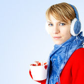 Girl holds cup of hot chocolate — Stock Photo