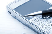 Pen, mobile phone and planner — Stock Photo