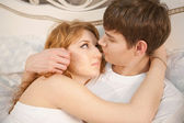 Romantic couple on the bed — Stock Photo