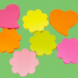 Royalty-Free Stock Photo: Colorful sticky notes isolated on green background