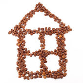 House icon is lined with coffee beans on white background — Stock Photo