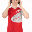 Young man in the red t-shirt with headphones on a white background — Stock Photo #9428016