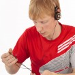 Young man unravels the tangled headset isolated — Stock Photo