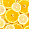 Stock Photo: Slices of oranges, lemons, citrus background