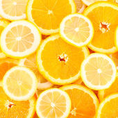 Slices of oranges, lemons, citrus background — Stock Photo