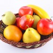 Many fruits and in basket isolated on white background — Foto Stock