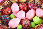 Basket full of easter eggs — Stock Photo