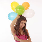 Happy teenage party girl with balloons over white — Stock Photo