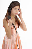 Nice teen girl with microphone and headphones, singing — Stock Photo