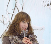 The beautiful girl with an ice icicle — Stock Photo