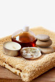 Spa candle, oil, stones and towel — Stock Photo