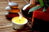 Spa candle, massage stones and oils — Stock Photo