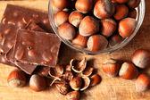 Bowl of hazelnuts and chocolate — Zdjęcie stockowe