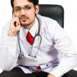 Doctor sitting on a chair — Stock Photo