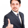 Confident businessman with thumbs up — Stock Photo