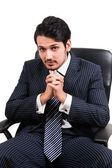 Confident businessman sitting on office chair — Stock Photo
