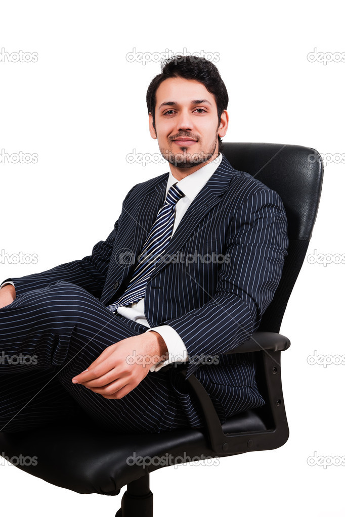 Portrait of a confident Arab businessman sitting on a chair, biracial businessman isolated on white — Stock Photo #8454011