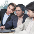 Stock Photo: Three businessmen in meeting
