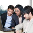 Three businessmen in meeting — Stock Photo