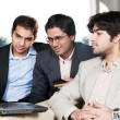 Three businessmen in meeting — Stock Photo #8830151