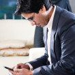 Businessman reading sms — Stock Photo