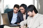 Three businessmen in meeting — Stock Photo