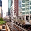 Train moving on the tracks in Chicago - Stock Photo