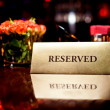 Reserved sign in restaurant — Stock Photo #8790448