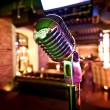 Retro microphone on stage — Stock Photo #9701909
