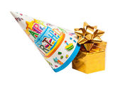 Brightly colored party hat with gift box — Foto Stock
