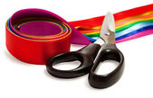 Scissors and a satin ribbons — Stock Photo