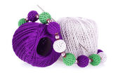 Two balls of cotton knitting yarn with crochet and knitted necklace — Stock Photo