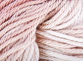 Beige and brown knitted yarn — Stock Photo