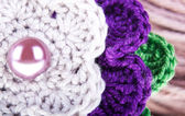 Colored knitted flower — Stock Photo