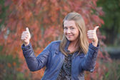 Pretty positive girl with thumbs up — Stock Photo