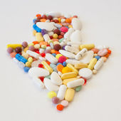 Multi-colored pills on the table — Stock Photo
