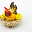 Two little chicks and hen in the nest - Stock Photo