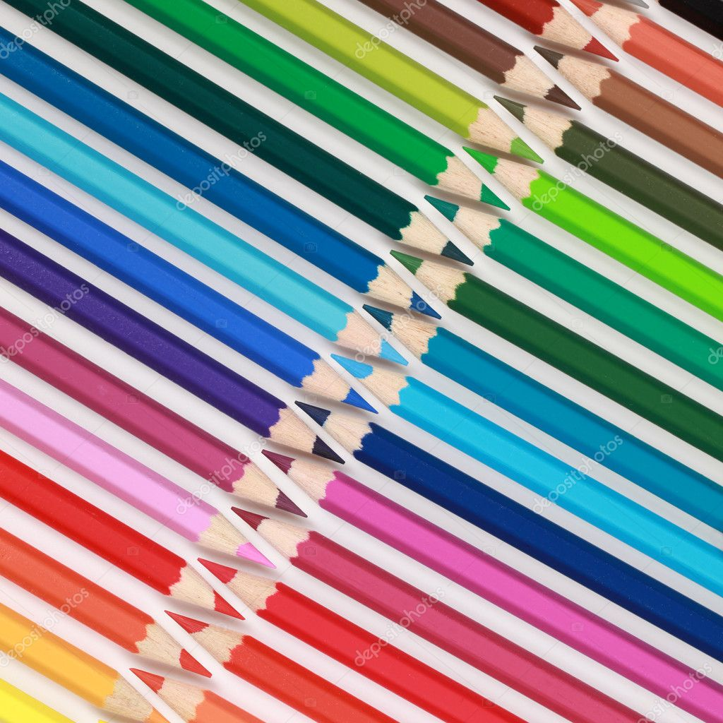 Colored crayons in a row forming a diagonal pattern. — Stock Photo #8625265