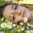 Girl relaxing in nature - Stock Photo