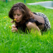 Beautiful girl lying on grass - Stock fotografie